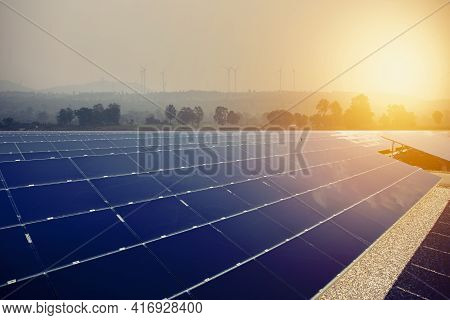 Alternative Energy For Energy Conservation In The World (solar Panels In The Sky) And Wind Turbines
