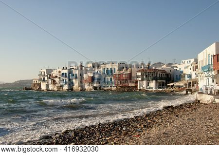 Panoramic View Of Traditional Beachfront Houses In The Village On The Island Of Mykonos In Greece. C