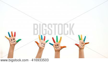 Banner View Of Children Hands In Colorful Paint With Funny Smile Face Isolated On White Background