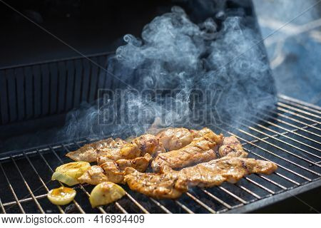 Whole Chicken Grilled On Hot Barbecue Charcoal Flaming Bbq Grill With Lovely Meat Smoke, Concept Of