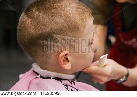 Children's Haircut For A Boy.stylish And Fashionable Hairstyle.hair Care Of The Child.short Hair.