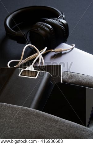 Modern Usb Gadgets: Smartphones, Laptop And Tablet Lie In A Gray Backpack Or Bag Along With An Exter