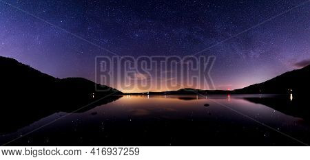 A View Of Bassenthwaite Lake At Night With A Faint Milky Way Arching Over The Lake And Stars And Lig