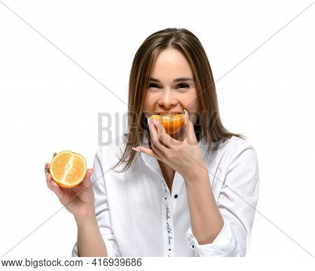 Cute Young Woman With Sour Face Eats A Sour Orange. Isolated On White Background