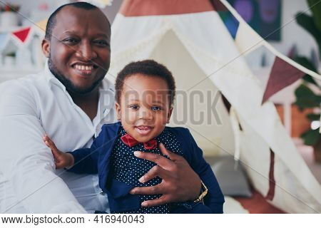 Portrait Of Happy Father And Son Having Fun Together At Home