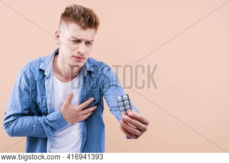 Portrait Of Sick Man In Casual Denim Shirt Is Clutching Chest, Suffering Acute Pain, Risk Of Infarct