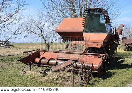 Old Rusty Disassembled Combine Harvester.old Soviet Combine