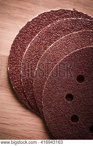 Sandpaper Round Pieces On A Wooden Table