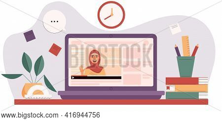Muslim Woman On The Laptop Screen. E-learning Concept. Workspace With Elements For Training. Online