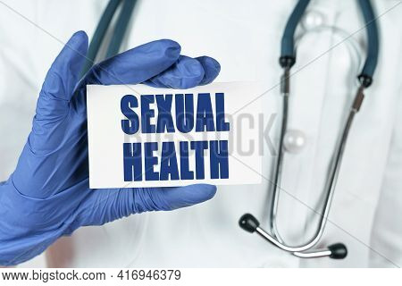 Medicine Concept. The Doctor Holds A Business Card That Says - Sexual Health