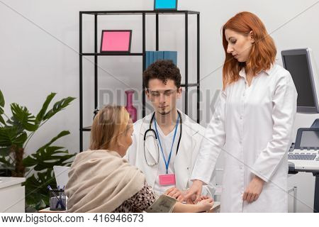 In A Physicians Office, A Nurse Practitioner Is Taking The Blood Pressure Of A Fifty-year-old Female