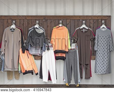 Casual Wear Hanging In Trade Shop. Trousers, Jackets, Gowns And Other Clothes