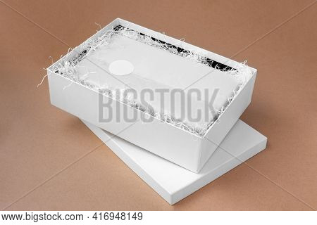 Mock-up Round Blank Sticker Or Tag For Brand Or Logo On White Tissue Paper, Unpacking, White Box On