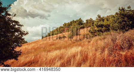 Beautiful Nature Landscape. Dry Grass On Meadow. Autumn Or Summer Season. Hill Terrain And Natural S