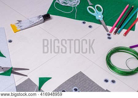 Working White Table For Home Crafts For A Child. Craft Tools, Objects And Accessories For Creativity