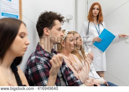 The Doctor Leaves The Doctors Office And According To The List Asks The Next Patient In Line. Close-