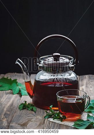 Herbal Tea With Mint And Lemon. Tea Cup And Teapot On  Table. Cup Of Aromatic Herbal Tea.tea Time. G