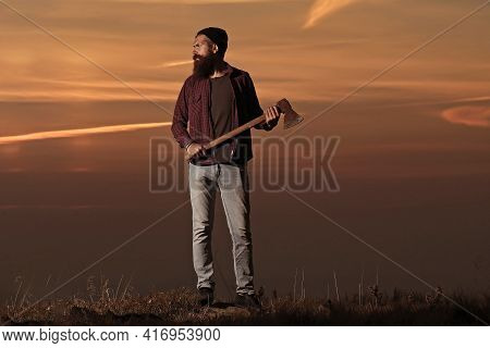 Carefree Happiness Freedom Concept. Hipster Man With Beard With Axe In Hand And Moustache In Hat Jum
