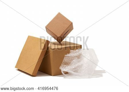 Close-up Shot Of Different Shaped Cardboard Boxes And Bubble Wrap Isolated On White Background