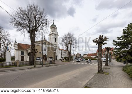 Janowiec Wlkp., Kujawsko-pomorskie Poland - April, 14, 2021: Catholic Temple In A Small Town. Church