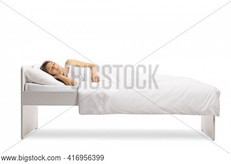 Young woman sleeping peacefully in a single bed under a white duvet cover isolated on white background