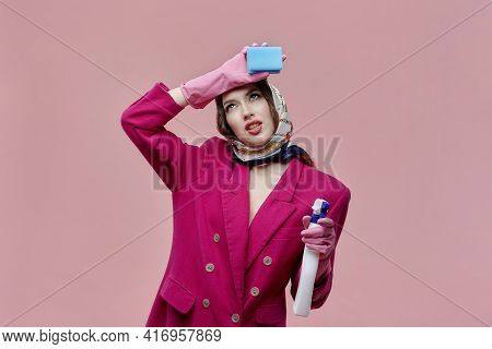 A Tired Woman Is A Cleaner With Bright Makeup. In The Hands Of Spray And Sponge.