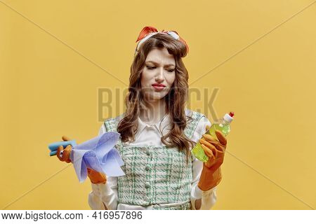 A Disgruntled, Sad Cleaning Lady Holds A Dish Detergent In Her Hand.
