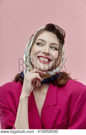 A Happy Young Woman With A Headscarf On Her Head And Bright Makeup. Pin-up Style