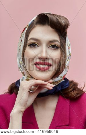 Happy Young Woman With Bright Makeup. A Headscarf. Pin-up Style.