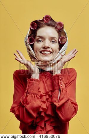 Portrait Of A Beautiful Happy Woman, With Curlers And A Headscarf On Her Head.