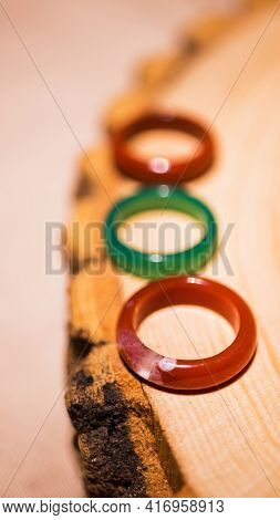 Vertical Photo Of Rings Made Of Colored Semi-precious Stones