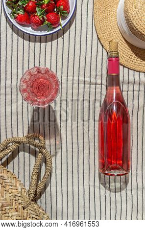 Picnic On A Sunny Day. Pink Champagne And Strawberries On A Striped Plaid. Flat Lay
