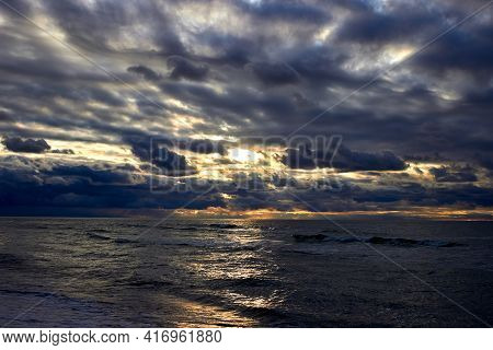 The Dramatic Sea And Sunbeams Make Their Way Through The Clouds