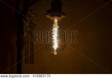Incandescent Bulb. Vintage Hanging Edison Light Bulb In A Dark, Spooky Room