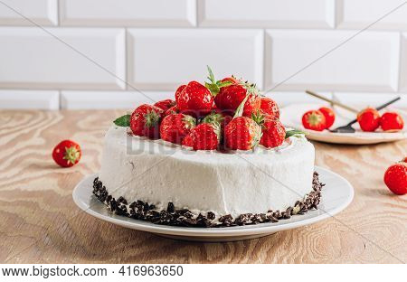 Whole Chocolate Cake With Strawberry Over Wooden Rustic Background.