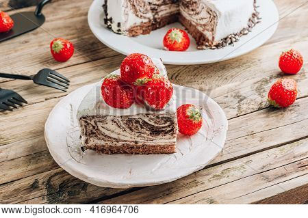 Chocolate Zebra Cheesecake With Fresh Strawberry Over Wooden Rustic Background.