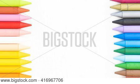 Colored Pencils On Both Sides Isolated On White Background Middle Copy Space