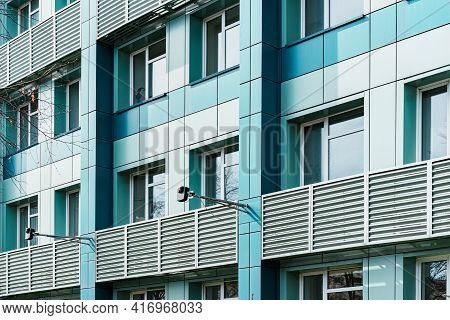 Blue Office Building With A Hinged Facade. Opaque Aluminium Panel. Panels. Details. Windows. Archite