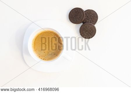 Cup Of Coffee On Saucer With Cookies Isolated On White Background And Copy Space For Text