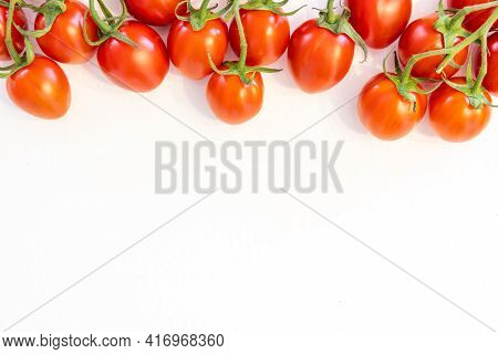 Branch Of Fresh Cherry Tomatoes Isolated On White Background With Copy Text On Bottom