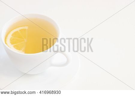 Single Cup Of Green Tea With Half Lemon Slice Isolated On White Background Copy And Space For Text