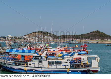 Pyeongtaek, South Korea; April 6, 2021:row Of Tour Boats And Fishing Trawlers Docked At Jeongok Mari