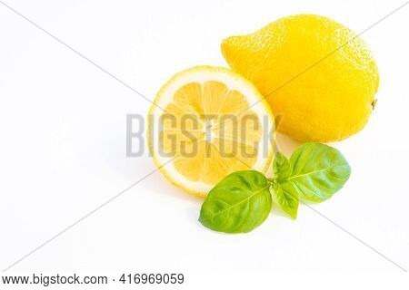 Whole Yellow Lemon Fruit With Half Lemon Isolated On White Background With Leaf And Copy Space