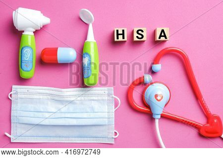 Wooden Block Written Hsa Or Health Spending Account With Medical Toy, Gold Chest And Fake Money. One