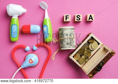 Wooden Block Written Fsa Or Flexible Spending Account With Medical Toy, Gold Chest And Fake Money. O