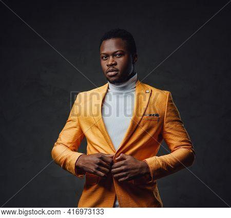 Elegant Businessman Of African Descent Buttons His Coat