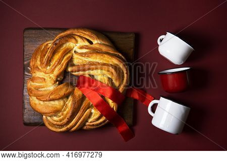 A Pie On A Red Background Is Decorated With A Red Ribbon, A Symbol Of Protest For Freedom In Belarus