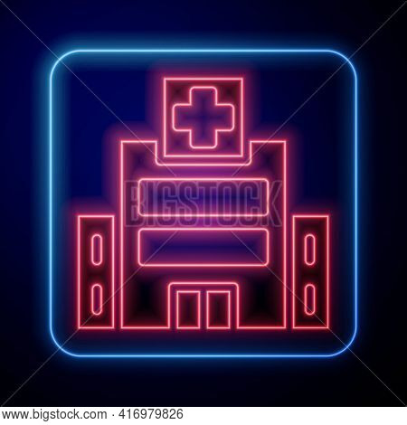 Glowing Neon Medical Hospital Building With Cross Icon Isolated On Blue Background. Medical Center.