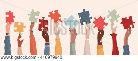Autism Syndrome Concept. Group Of Raised Arms Of Diverse People Holding A Jigsaw Piece. Learning Sup