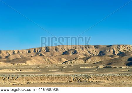 View Of The Hills In The Desert. Beautiful Relief Patterns Of The African Desert